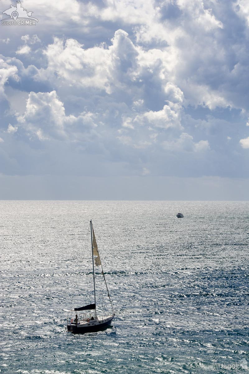 Sailing Yacht in Black Sea against Storm Clouds