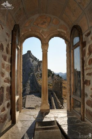 Fortification Wall through a Window of Consular Castle in Sudak Fortrees
